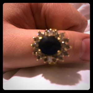 Blue saline sapphire surrounded by 3Ct. diamonds